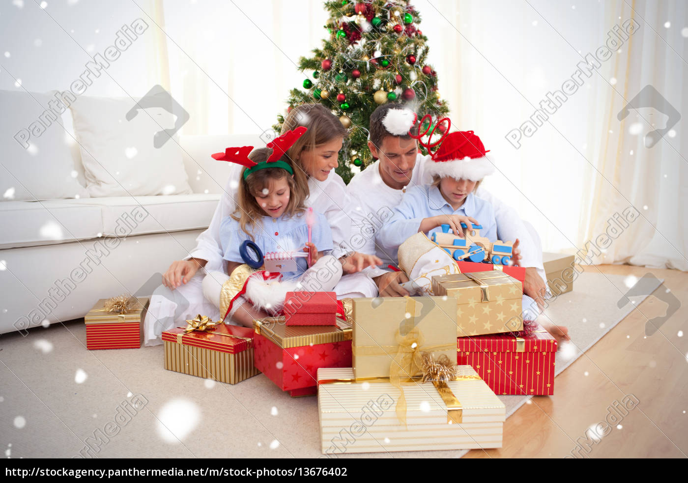 young, family, unpacking, christmas, presents - 13676402