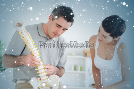 chiropractor and patient looking at a