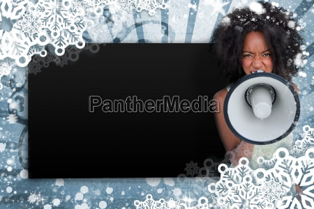 girl with afro shouting through megaphone