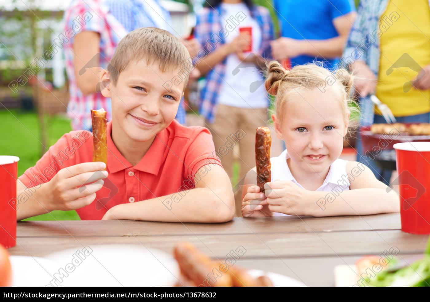 enjoying, barbecued, sausages - 13678632
