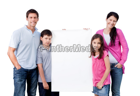 happy family outside with a blank