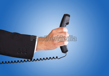 businessman's, hand, holding, telephone, receiver - 13679032