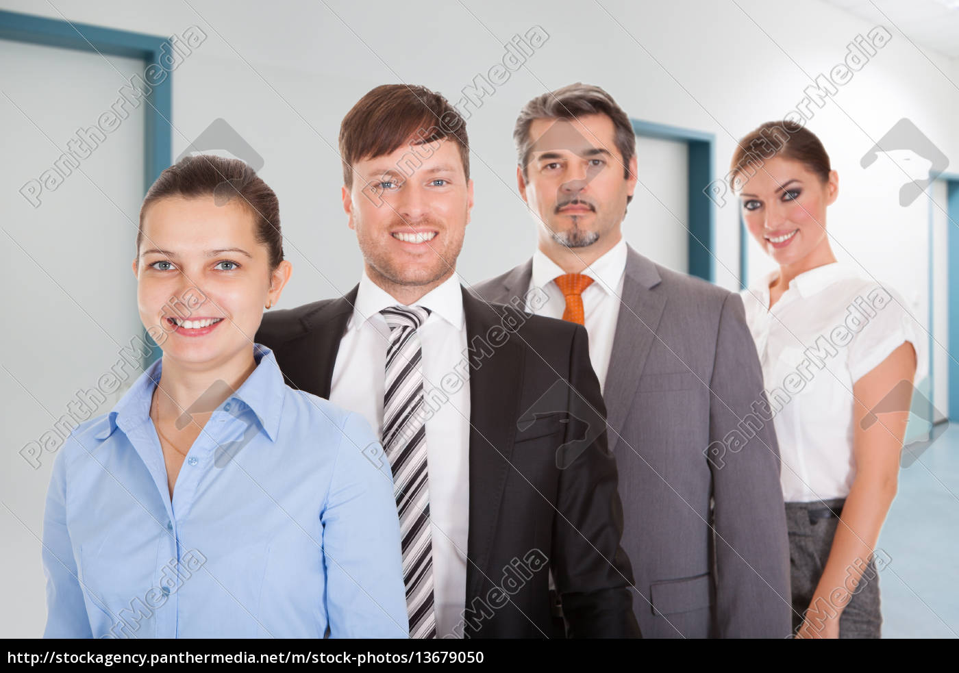 businesspeople, standing, in, a, row - 13679050