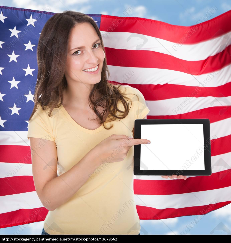 smiling, woman, holding, digital, tablet - 13679562