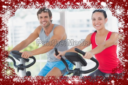 smiling young couple working out at
