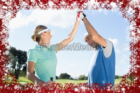 golfing couple high fiving on the