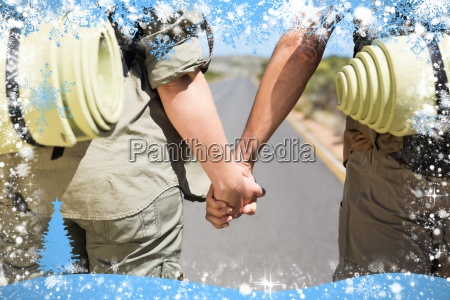 hitch hiking couple standing holding hands