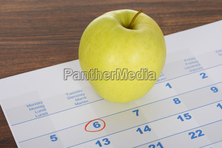 apple on calendar marked with marker