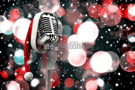 composite image of microphone with santa