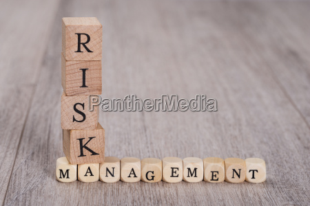risk management blocks on table