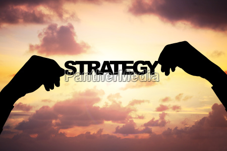 silhouette businessmans hands holding strategy during