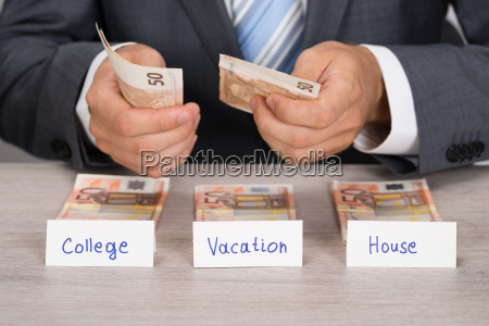businessman saving money for college vacation