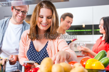 cook friends pasta and meat at