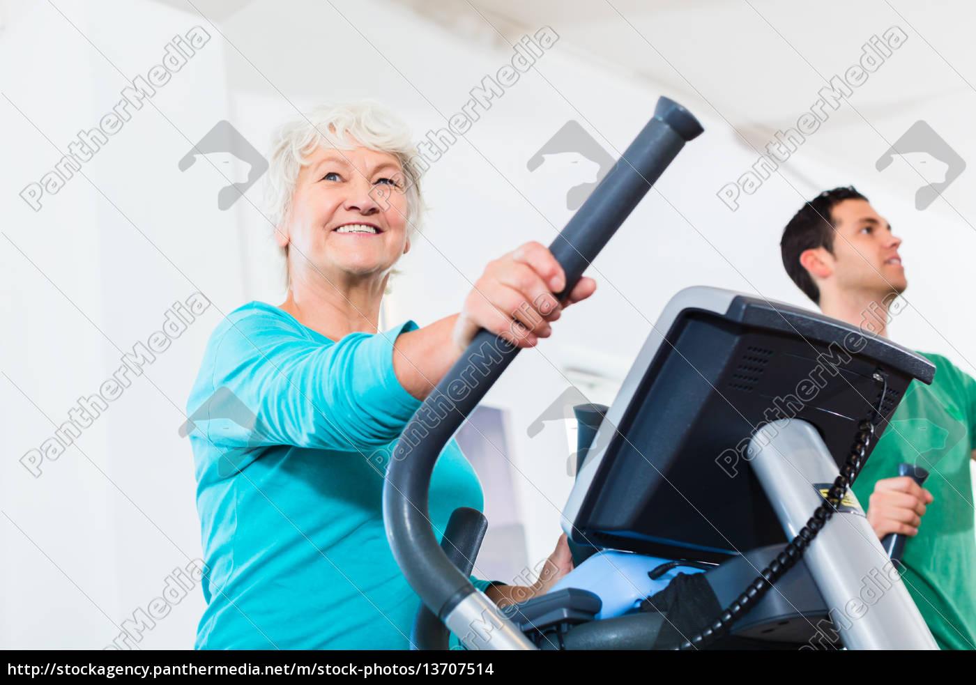 senior, on, eliptical, trainer, makes, sport - 13707514