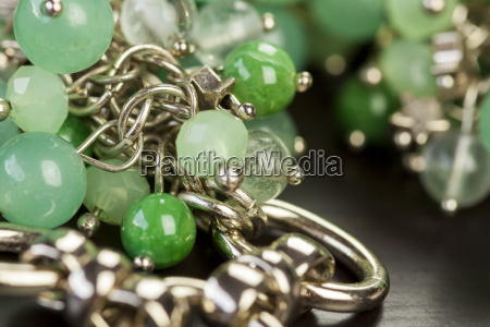 silver necklace bracelet with green gemstones