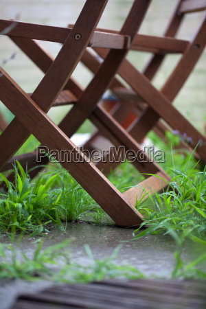 wooden folding chairs in a garden