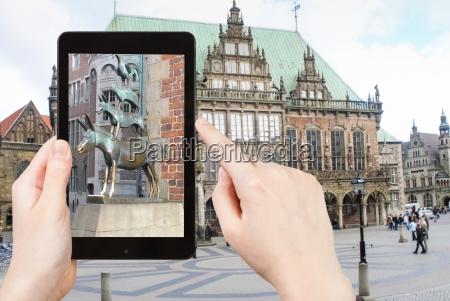 tourist taking photo of bremen town