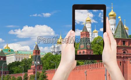 tourist taking photo of moscow kremlin