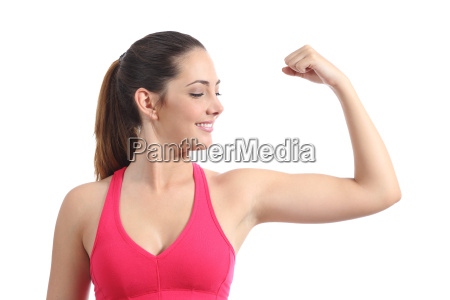 fitness woman looking her biceps muscle