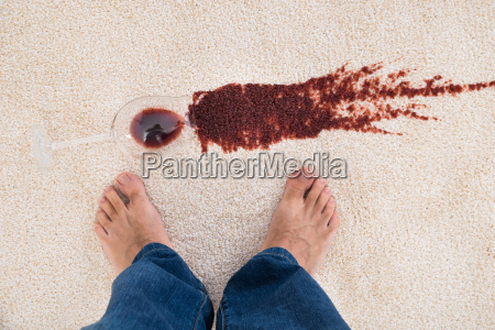 person, standing, near, wine, spilled, on - 13716453