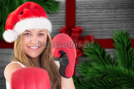 composite image of festive blonde punching