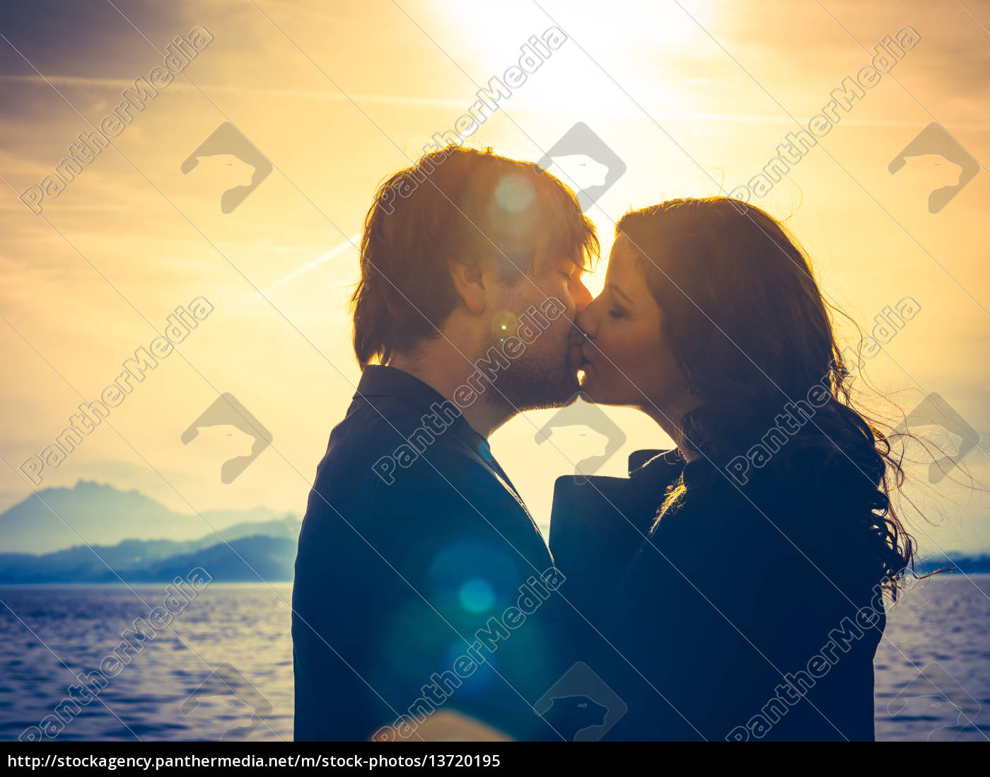 young, couple, kissing, in, the, sunlight - 13720195