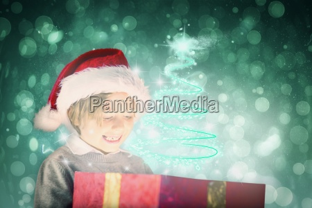 composite image of festive boy opening