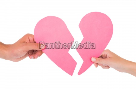 couple holding two halves of broken