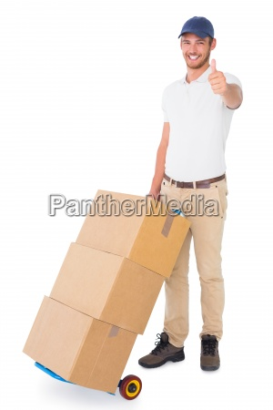happy delivery man pushing trolley of