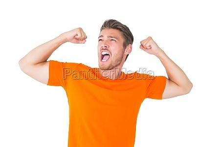 excited man in orange cheering