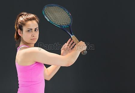 portrait of confident female tennis player