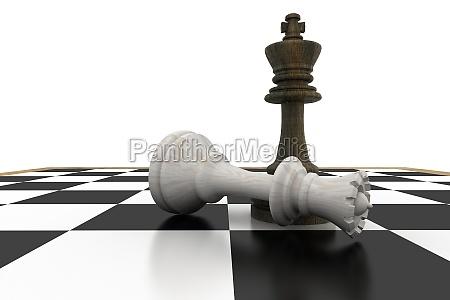 black king standing over fallen white