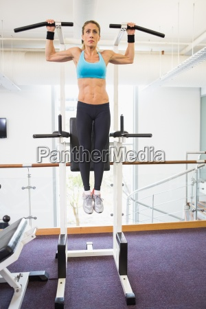 fit woman doing crossfit fitness workout
