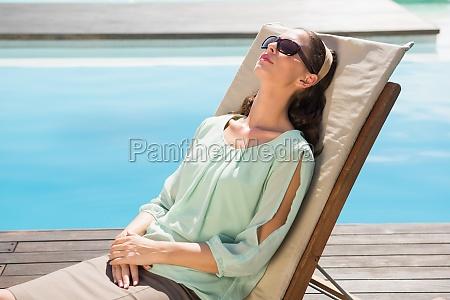 beautiful woman relaxing on sun lounger