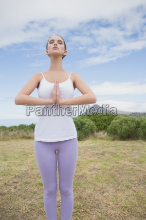 woman with hands joined standing on