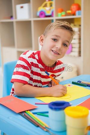 cute little boy making art in