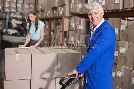 warehouse foreman smiling at camera with