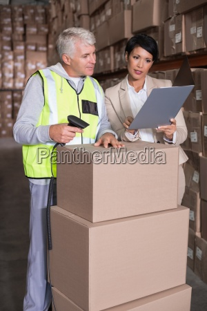 warehouse, worker, scanning, box, with, manager - 13744121