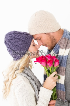 attractive couple in warm clothing holding