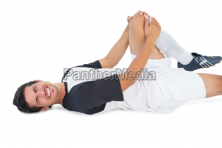 soccer player lying down and shouting