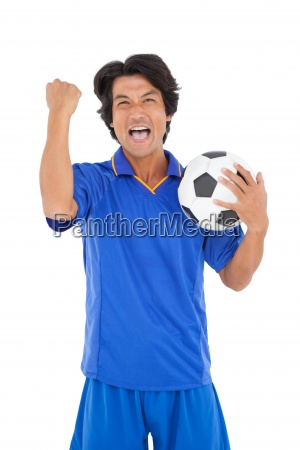portrait of a football player cheering