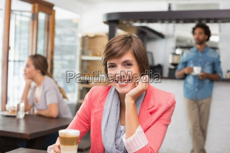 pretty brunette enjoying her latte
