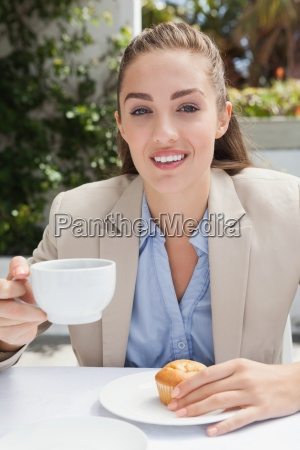 beautiful businesswoman having a coffee and