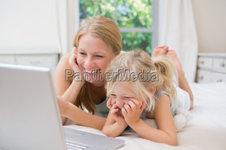 cute little girl and mother on
