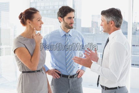 businessman chatting with co worker