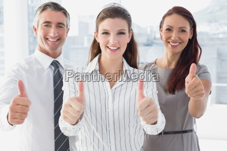 smiling, businesswoman, giving, thumbs, up - 13748691