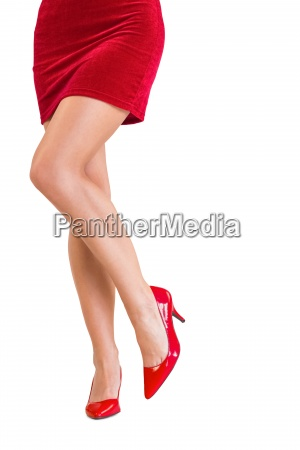 lower half of girl in red