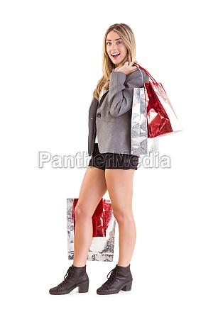 stylish blonde holding shopping bags