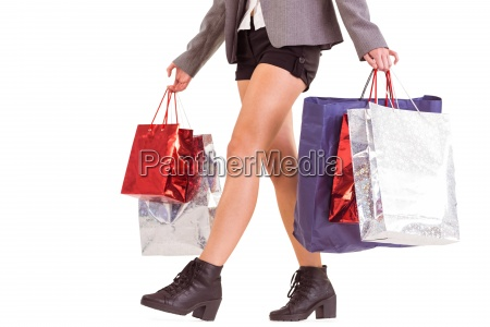 lower half of woman with shopping
