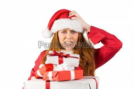 festive stressed redhead holding gifts